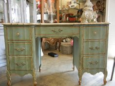 This desk is painted in Annie Sloan Chalk Paint. Colors Old White,Duck Egg, Clear Wax and Dark Wax.