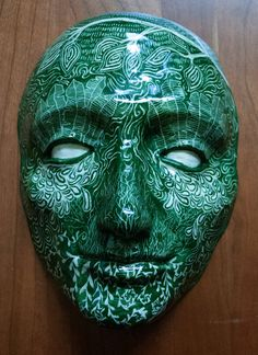Slip cast earthenware mask, vignette of the life cycle. Decorated in sgraffito, hand made one of a kind. Very light, recommend a stand or plate-hanger