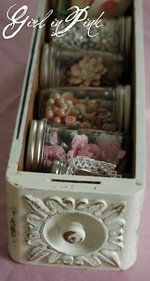 Craft supplies in a sewing machine drawer - cute to as a tray to hold make up, lotions, etc in a bathroom