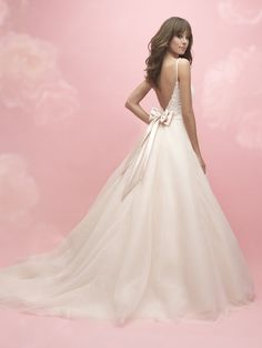 Allure Romance Style 3050, a stunning V-neck ball gown, with spaghetti straps, lace bodice and beautiful bow detail