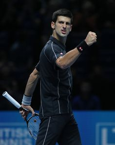 Novak Djokovic of Serbia celebrates at match point as he defeats Richard Gasquet of France in their ATP world Tour Finals tennis match at the O2 Arena on London, Saturday, Nov. 9, 2013. (AP)