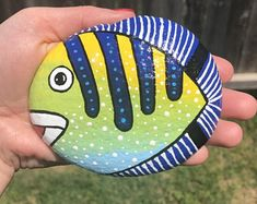 Check out our fish painted rocks selection for the very best in unique or custom, handmade pieces from our home décor shops. Lady Bug Painted Rocks, Turtle Painted Rocks, Painted Rock Animals, Painted Rocks Kids, Painted River Rocks, Mandala Painted Rocks, Rock Painting Patterns, Rock Painting Ideas Easy, Rock Painting Designs