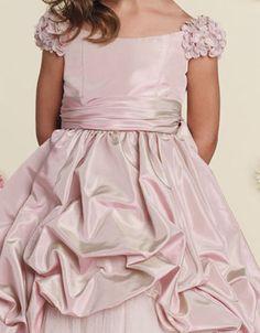 Princess dress with interesting flower petal sleeves.