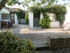 Location vacances Maison Rivedoux-Plage (M0879) - My Home In Ile de Ré Porches, A Frame House, Spanish House, Interior Garden, Terrace Garden, Modular Homes, Small Gardens, Little Houses, Backyard Patio