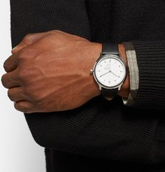 Mr Martin Drechsel, designer of <a href='http://www.mrporter.com/Shop/Designers/Mondaine'>Mondaine</a>'s line of Helvetica watches, lauds the namesake font for its 'discreet, versatile character and great functional qualities'. Crafted in Switzerland from durable stainless steel with a scratch and shatter-resistant sapphire crystal cover, this handsome timepiece embodies those same enduring attributes. Typography buffs take note - not only are the indexes and text on the watch set in…
