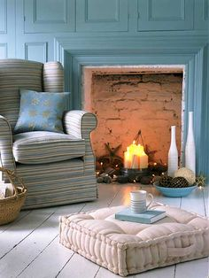 """Even when it is too warm for a blazing fire, you can use your fireplace to create atmosphere by adding candles or even white sting lights. For an extra touch, lean a mirror against the back wall to add extra dimension. (Photo: IPC Images)"""
