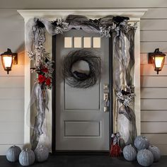 Your neighbors will envy your Halloween decorated door. It's easy to create this DIY look with supplies from your local Michaels store.