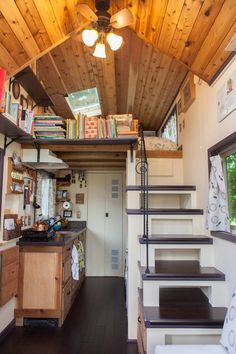 The kitchen has eight feet of counter space, custom cedar kitchen cabinets, a portable gas cooktop, and pull out garbage and recycling bins.
