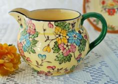 A pretty vintage 'Tuscan Decoro' jug decorated with turquoise, yellow and pink flowers. A great pitcher for milk or sauces perhaps. c.1930 by Alexsprettyvintage on Etsy