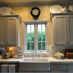 Kitchen cabinets quiet colors, farmhouse sink. Marble counter tops.  annie sloan chalk paint paris grey cabinets - Google Search love the plates on top of the cabinets