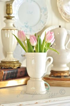 Tea cup vase made from old tea and coffee cups. Very inexpensive and it's a great idea for a centerpiece at a shower or Mother's day!