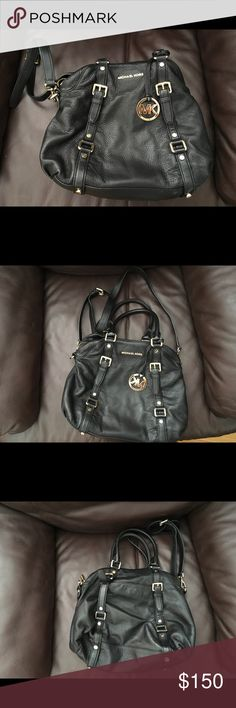 MK purse! Black leather Michael Kors purse. Handles but also comes with body strap. Side zip pocket on one side and pockets on the other Michael Kors Bags Shoulder Bags