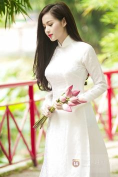 A lady in ao dai with lotus, Viet Nam