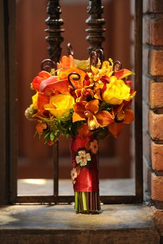 Gorgeous bouquet featuring fall colors. Photo by Edmonson Weddings. www.wedsociety.com #fall #wedding #bouquet
