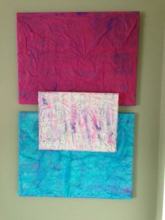 Mod podge tissue paper to canvas.