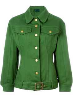 Jean Paul Gaultier Vintage 'La Concierge Est Dans L'Escalier' jacket £390  Green cotton 'La Concierge Est Dans L'Escalier' jacket from Junior Gaultier Vintage featuring a pointed collar, a front button fastening, long sleeves, button cuffs, two button fastening chest pockets and a buckled belt at the hem. Circa 1998