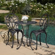 This French-style outdoor bistro set will lend classy style to your patio. The set is constructed of cast aluminum in dark gold color, with cast iron legs for stability. The two-person set includes one table with smooth tabletop, and two chairs.