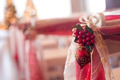 Ceremony Décor for a winter wedding. Holly berries, ornaments and a hint of gold. Lovely!