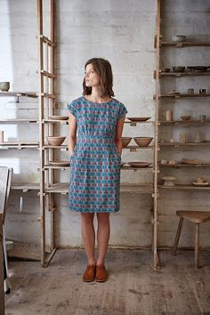 I love cap sleeves for summer, and the color and pattern are perfect for my style. The length is great for work.