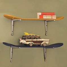Here is a skateboard shelf sold at PB Teen. Maybe we could do something  like this with one of the old lodge skis