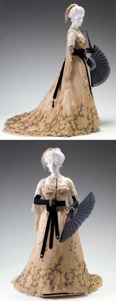 House of Worth (Paris), ca. 1895-1900. Reception gown (bodice and skirt). Gown is ivory silk chiffon and ivory silk net over which  black Alençon lace appliqués have been sewn. Underskirt is ivory silk. The designer's eye for detail and flawless workmanship, as seen in this dress, is characteristic of the high quality of French couturier fashions of the late 19th century. This elegant gown is typical of just one of 7 or 8 outfits a fashionable lady might wear in a single day.