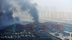 Smoke rises from shipping containers after explosions at Binhai new district in Tianjin, China, August 13, 2015. © China Stringer Network
