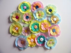 """Flowers"" out of cupcake liners and buttons. So cute!"