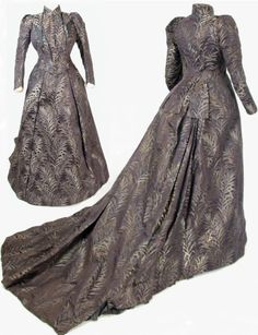 Two-piece afternoon dress, Peter Robinson Mourning Warehouse, London, ca. 1889. Black silk figured w/silvery cream & gray willow leaf design. Cuirasse-style bodice w/short stand-up collar w/net underfrill & 23 silk-covered spherical metal buttons at front opening. False lapels, pointed waistline, 4 basque tabs at back. Coat sleeves gathered at elbow, slit cuffs w/6 buttons & pleated net underfrill. Black silk facings, brown twill lining, boned, weighted basques. National Trust (UK)