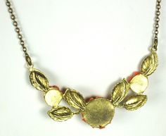 30% off Sale until 11/21/15 Coral Plastic #Floral Necklace. This great piece is composed of a strong #gold toned metal chain that leads down to a very unique floral centerpiece. This section is made up ... #vintage #diamonds #rings #necklace #coral #flowers #rose #floral #fall #gift #classic #judysgems2 #autumn