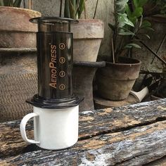 Brewing in the garden  by @aelpo |  TAG your coffee friend! |  Shop NOW: http://ift.tt/1uHcmzT Link in Bio  @originalaeropress by originalaeropress