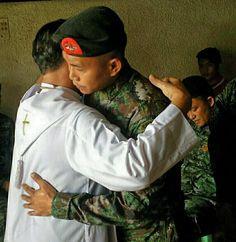 """Religion knows no bounds. We are all children of God. In His eyes we are all equal. God's Love has no limit. This picture """"In Solidarity"""" shows a Catholic Priest and a Muslim Soldier wept as one for SAF Fallen 44."""