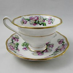 """Beautiful bone china tea cup and saucer by Royal Albert. Hand painted flowers and gold trimming. Pattern is May Blossom. Excellent condition (see photos). The markings read: Royal Albert Bone China England """"May Blossom"""" Please bear in mind that these are vintage items and there may"""