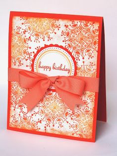 handmade birthday  card: Summer snowflakes {Gina K Designs} ... monochromatic oranges ... snowflakes as design element in the background ...