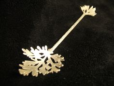 Absinthe spoon, Sterling silver, hand made modern, absinthe leaf shaped. £100.00, via Etsy.