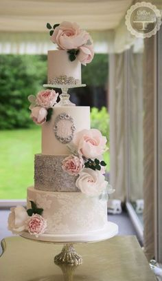 Beautiful soft silver and white wedding cake from Cotton and Crumbs. Filled with big, lush flowers, covered in lace and shimmery silver glitter.