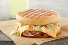 A turkey panini gets a serious flavor upgrade with fixings that include creamy coleslaw, melty cheese and tangy BBQ sauce.