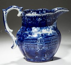 """Jeffrey Evans 6/17/17 lot 1690 right. Est: $200 - 300. Realized: $380.  Desc: HISTORICAL BLUE STAFFORDSHIRE PITCHER, """"Esplanade & Castle Garden, New York"""" on one side & """"Almshouse, Boston"""" on the other with molded handle. Likely Ralph Stevenson, Cobridge, Staffordshire, Eng. Ca. 1830. 7 7/8"""" H.  Professional restoration to spout & rim.  Literature: TCC database pattern #2371 & #2373. Provenance: Kurt & Barbara O' Hare coll., Putnam Valley, NY. Purchased from Bill & Theresa Kurau, Lampeter…"""