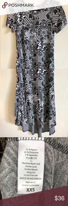 LuLaRoe XXS Carly Black and White Star Jaquard This LuLaRoe XXS Carly is another unicorn! 🦄 Amazing black and white star print has everything from florals, to snowflakes, to paw prints on it! 🌸❄️🐾 Washed twice and worn once, it is in excellent used condition and has plenty of love to give! LuLaRoe Dresses High Low