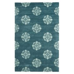 Hand-tufted wool rug with medallion motif.Product: RugConstruction Material: WoolColor: Blue...
