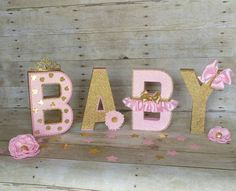 This listing is just for 4 paper maché free standing decorated letters ... perfect for a royalty baby shower theme, party decoration , cake table , nursery room or for a photo prop for your little princess, baby shower and much more. .  YOU CAN CHOOSE HOW YOU WANT YOUR LETTERS.....  If you need the ONE word just let me know... Can also be made with other ages AND WORDS....If you need a different quantity of letters please feel free to contact me....  The measure of this letters are about 8 hi...