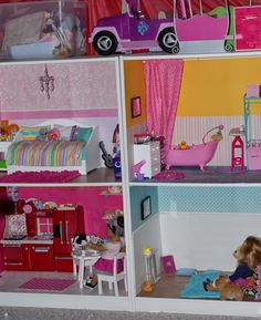 So we have been working (from time to time at least) on the girls a dollhouse for their American Girls since last Christmas. We used 2 Pax s...