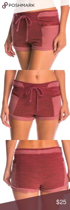 NWT Free People Cheeky Yoga Shorts Short shorts that measure 9 1/2 inches in length, 13 1/2 inches relaxed waist, and a 1 1/2 inch inseam. Gorgeous reddish and off reddish color (the tag says plum color). Features a draw string waist and a zippered pocket on both front sides. Super comfortable sweatshirt material with a booty hugging fit. I'm only looking to sell at this time so I'm not open to trades. My listing price is firm. Free People Shorts