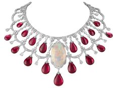VAN CLEEF & ARPELS. Zanzibar necklace, Les Voyages Extraordinaires High Jewellery Collection, white gold, round diamonds, marquise, baguette-cut and pear-shaped diamonds, 17 rubellite drops and large opal.