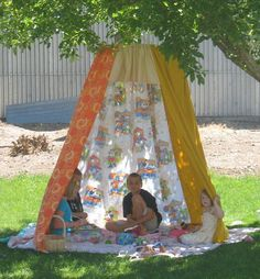 Make a play tent for kids out of sheets, rope and hula hoop for the backyard.