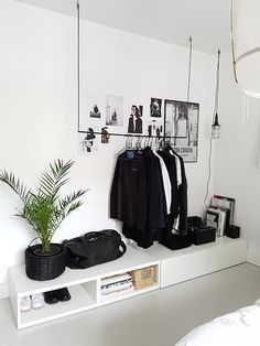 Open wardrobe in minimalist bedroom.