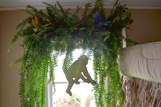 In the boy's themed jungle room at Bachman's Spring Ideas House.  Using permanent ferns as the window covering.