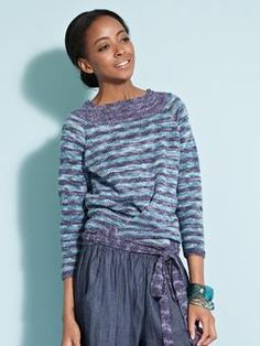 This beautiful 3/4 sleeve sweater, with a waist wrap around detail, is a must have garment in our new Summerspun yarn.