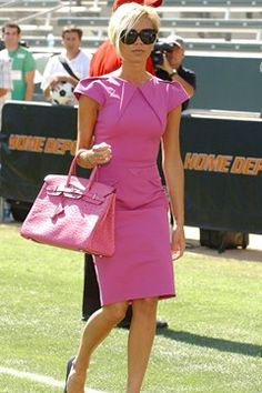 July 2007  Mrs Beckham wore a fuchsia RM by Roland Mouret dress with her matching Hermès ostrich Birkin bag and Balenciaga shoes at her husband's official presentation by the Los Angeles Galaxy team in LA. Photo By