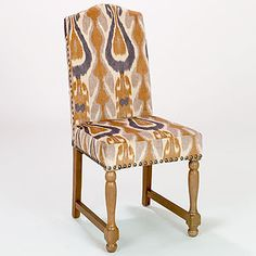really want two of these for my dining room. $150 ea. Amber Ikat Walter Chair | World Market