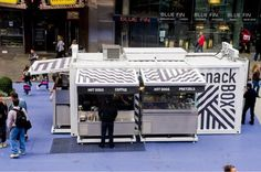 Container-like Times Square sidewalk food vendor. Won Retail Design 2011 Store of the Year: http://www.retaildesigninstitute.org/